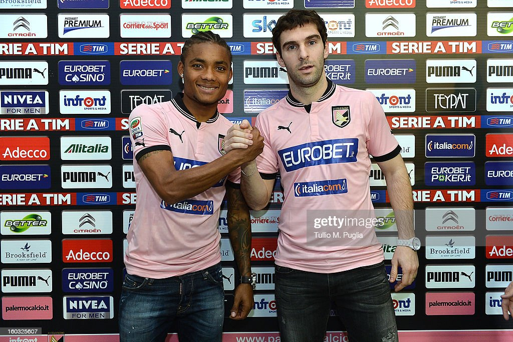 Nelson (L) and Mauro Boselli (R) pose wearing their new team shirt during their presentation as new players of Palermo at Tenente Carmelo Onorato Sports Center on January 29, 2013 in Palermo, Italy.