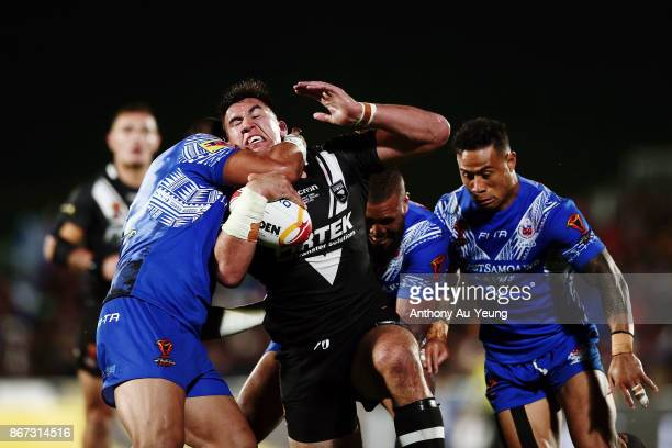 Nelson AsofaSolomona of the Kiwis is tackled during the 2017 Rugby League World Cup match between the New Zealand Kiwis and Samoa at Mt Smart Stadium...