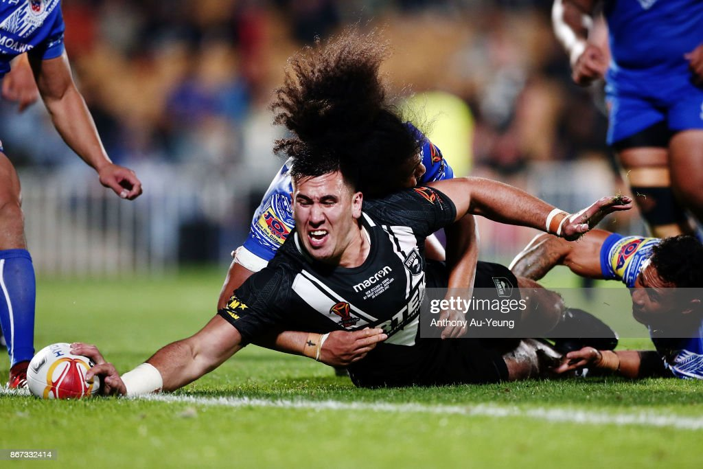 Nelson Asofa-Solomona of the Kiwis scores a try against Bunty Afoa of Samoa during the 2017 Rugby League World Cup match between the New Zealand Kiwis and Samoa at Mt Smart Stadium on October 28, 2017 in Auckland, New Zealand.
