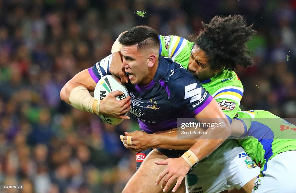 Nelson Asofa-Solomona of the Storm is tackled by Iosia Soliola of the Raiders during the round 26 NRL match between the Melbourne Storm and the Canberra Raiders at AAMI Park on September 2, 2017 in Melbourne, Australia.