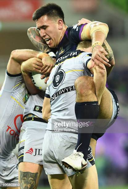 Nelson AsofaSolomona of the Storm is tackled by Kyle Laybutt of the Cowboys during the round 15 NRL match between the Melbourne Storm and the North...