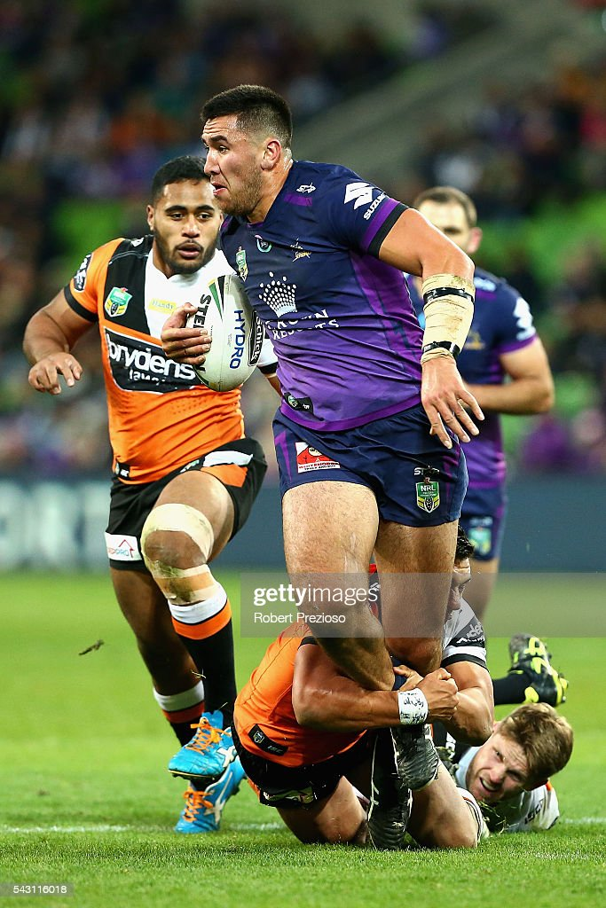 Nelson Asofa-Solomona of the Storm is tackled during the round 16 NRL match between the Melbourne Storm and Wests Tigers at AAMI Park on June 26, 2016 in Melbourne, Australia.