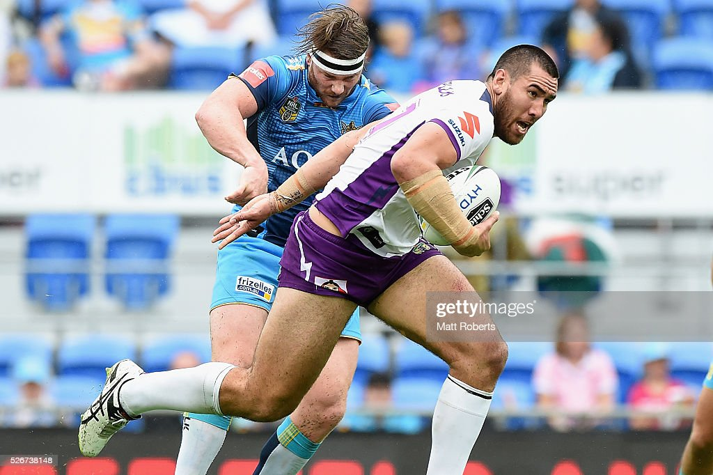 Nelson Asofa-Solomona of the Storm makes a break during the round nine NRL match between the Gold Coast Titans and the Melbourne Storm on May 1, 2016 in Gold Coast, Australia.