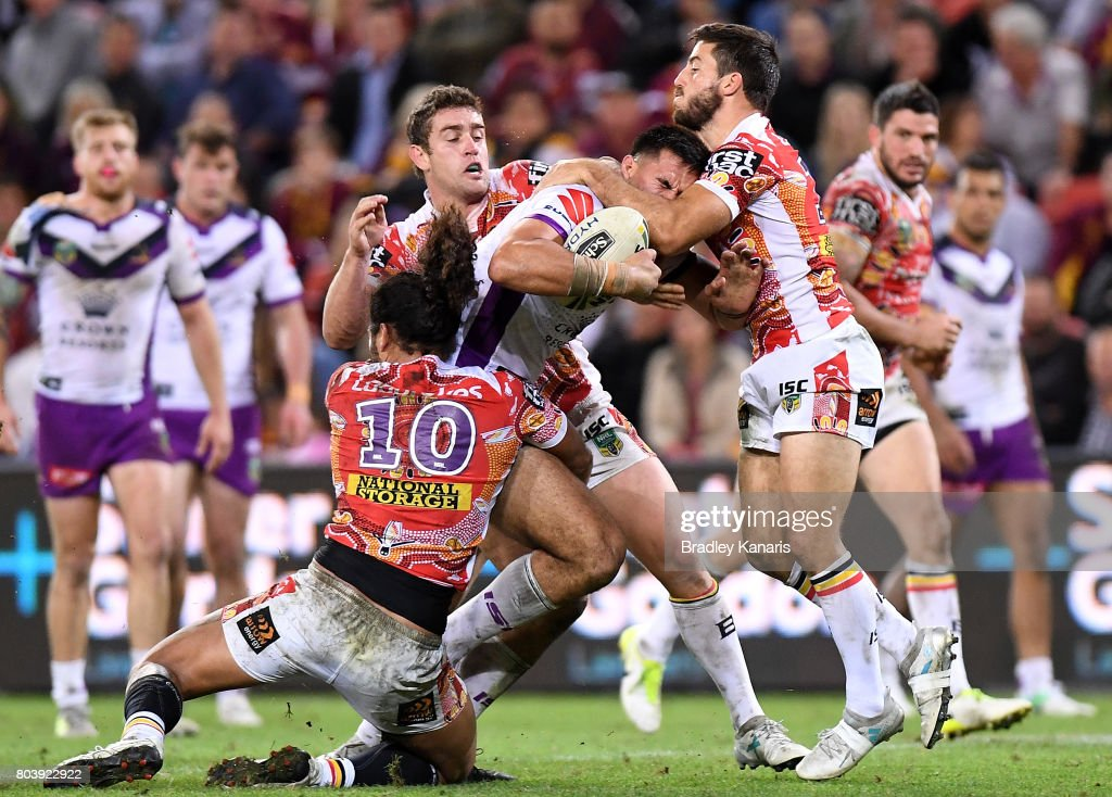 Nelson Asofa-Solomona of the Storm takes on the defence during the round 17 NRL match between the Brisbane Broncos and the Melbourne Storm at Suncorp Stadium on June 30, 2017 in Brisbane, Australia.