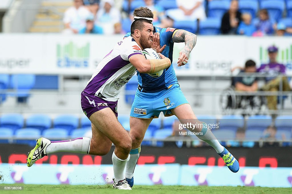 Nelson Asofa-Solomona of the Storm takes on the defence during the round nine NRL match between the Gold Coast Titans and the Melbourne Storm on May 1, 2016 in Gold Coast, Australia.