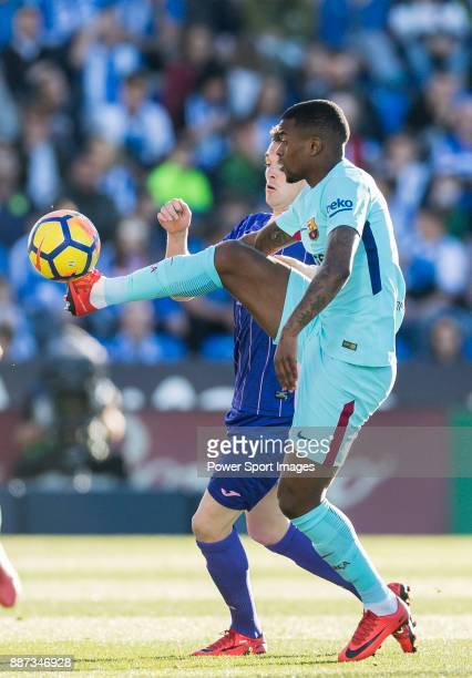 Nelson Cabral Semedo of FC Barcelona fights for the ball with Javier Eraso Goni of CD Leganes during the La Liga 201718 match between CD Leganes vs...