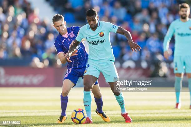 Nelson Cabral Semedo of FC Barcelona fights for the ball with Alexander Szymanowski of CD Leganes during the La Liga 201718 match between CD Leganes...