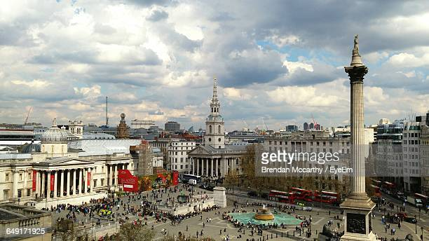 Nelson Column At Trafalgar Square In City Against Cloudy Sky