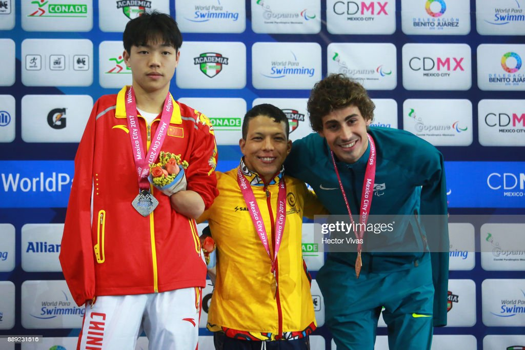 Nelson Crispin of Colombia Gold Medal, Hong Yan of China Silver Medal and Talisson Glock of Brazil Bronze medal pose after the men's 200 m Individual Medley M6 celebration during day 7 of the Para Swimming World Championship Mexico City 2017 at Francisco Marquez Olympic Swimming Pool. on December 7, 2017 in Mexico City, Mexico.
