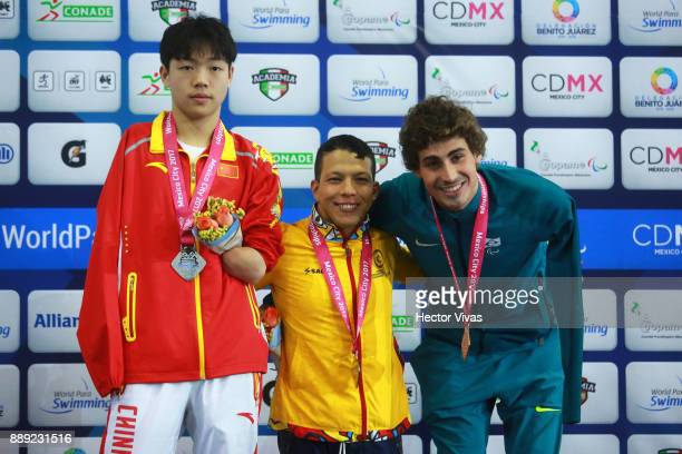 Nelson Crispin of Colombia Gold Medal Hong Yan of China Silver Medal and Talisson Glock of Brazil Bronze medal pose after the men's 200 m Individual...