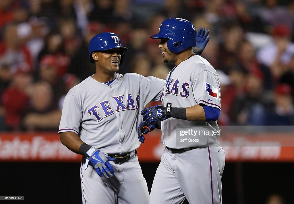 <a gi-track='captionPersonalityLinkClicked' href=/galleries/search?phrase=Nelson+Cruz&family=editorial&specificpeople=235459 ng-click='$event.stopPropagation()'>Nelson Cruz</a> (R) #17 of the Texas Rangers is congratulated by <a gi-track='captionPersonalityLinkClicked' href=/galleries/search?phrase=Adrian+Beltre&family=editorial&specificpeople=202631 ng-click='$event.stopPropagation()'>Adrian Beltre</a> #29 after hitting a three-run home run in the fourth inning against the Los Angeles Angels of Anaheim at Angel Stadium of Anaheim on April 24, 2013 in Anaheim, California.