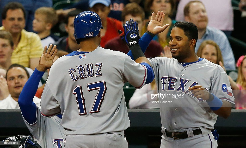 <a gi-track='captionPersonalityLinkClicked' href=/galleries/search?phrase=Nelson+Cruz&family=editorial&specificpeople=235459 ng-click='$event.stopPropagation()'>Nelson Cruz</a> #17 and <a gi-track='captionPersonalityLinkClicked' href=/galleries/search?phrase=Elvis+Andrus&family=editorial&specificpeople=4845974 ng-click='$event.stopPropagation()'>Elvis Andrus</a> #1 of the Texas Rangers celebrate at the dugout after Cruz hit a solo home run in the sixth inning to left field against the Houston Astros at Minute Maid Park on May 10, 2013 in Houston, Texas.
