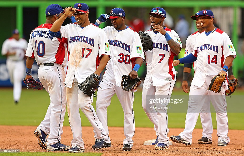 Nelson Cruz #17 and Robinson Cano #24 of the Dominican Republic celebrate after winning a World Baseball Classic second round game against Italy at Marlins Park on March 12, 2013 in Miami, Florida.