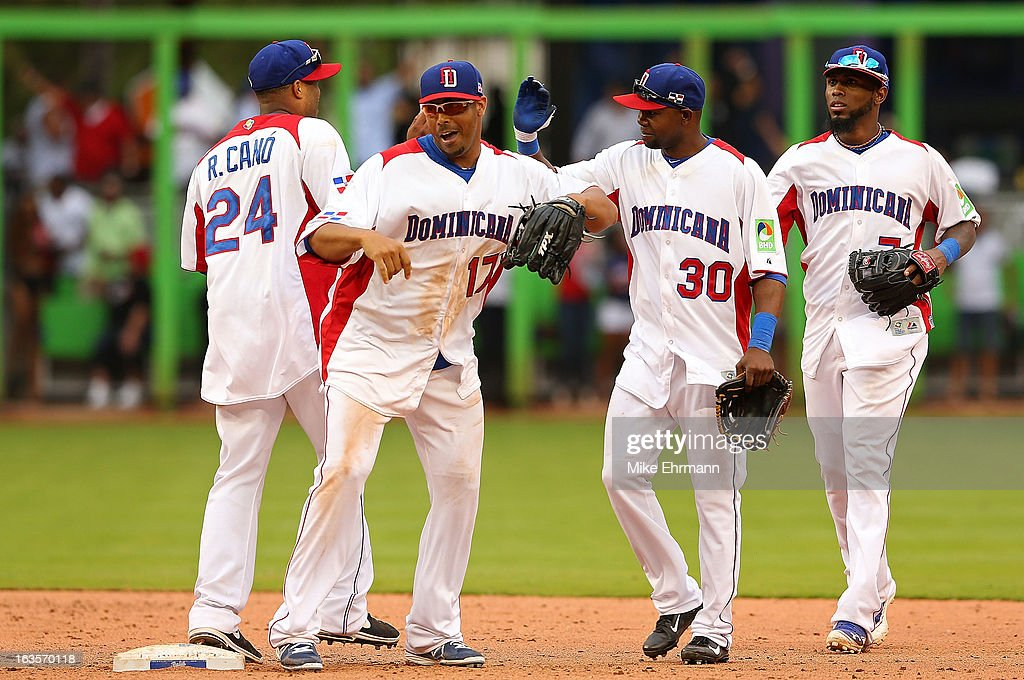 <a gi-track='captionPersonalityLinkClicked' href=/galleries/search?phrase=Nelson+Cruz&family=editorial&specificpeople=235459 ng-click='$event.stopPropagation()'>Nelson Cruz</a> #17 and <a gi-track='captionPersonalityLinkClicked' href=/galleries/search?phrase=Robinson+Cano&family=editorial&specificpeople=538362 ng-click='$event.stopPropagation()'>Robinson Cano</a> #24 of the Dominican Republic celebrate after winning a World Baseball Classic second round game against Italy at Marlins Park on March 12, 2013 in Miami, Florida.