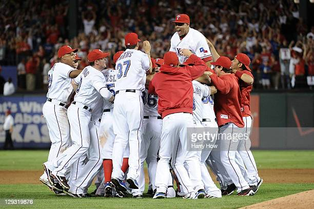 Nelson Cruz and the Texas Rangers celebrate winning Game Six of the American League Championship Series 155 against the Detroit Tigers to advance to...