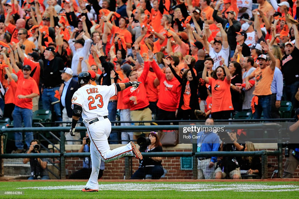 <a gi-track='captionPersonalityLinkClicked' href=/galleries/search?phrase=Nelson+Cruz&family=editorial&specificpeople=235459 ng-click='$event.stopPropagation()'>Nelson Cruz</a> #23 of the Baltimore Orioles celebrates after hitting a two run home run to right center field against Max Scherzer #37 of the Detroit Tigers in the first inning during Game One of the American League Division Series at Oriole Park at Camden Yards on October 2, 2014 in Baltimore, Maryland.