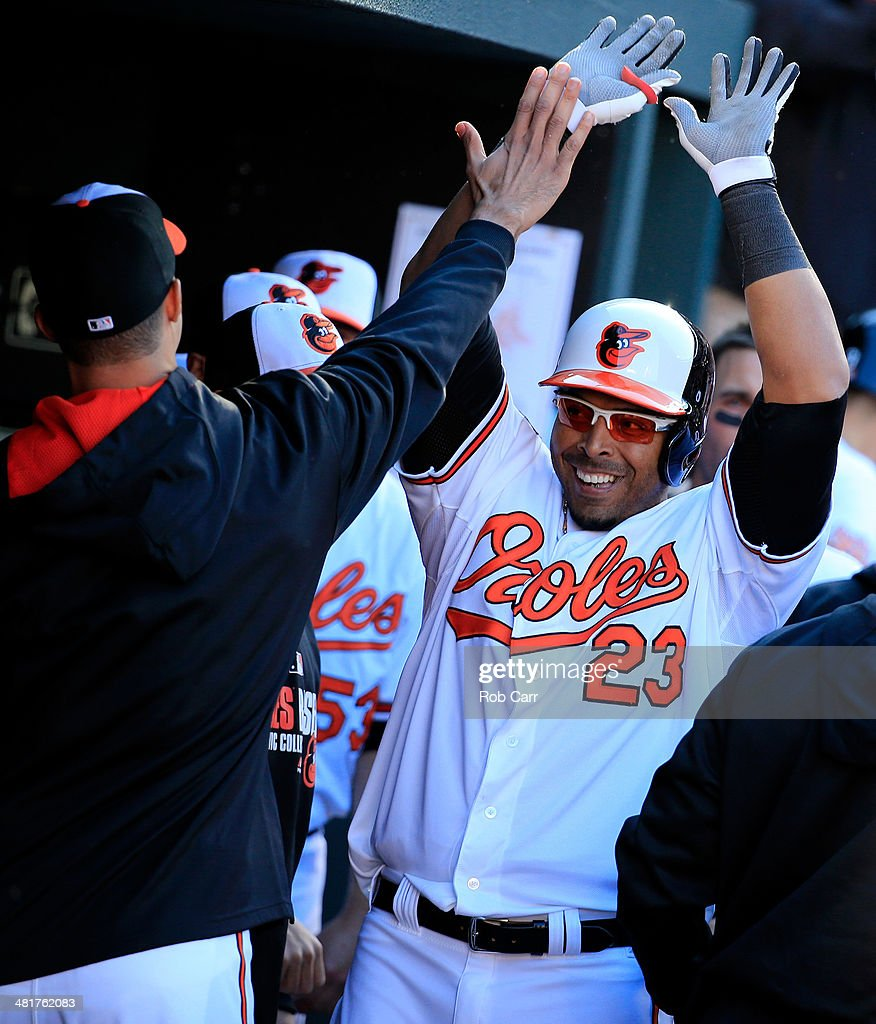 <a gi-track='captionPersonalityLinkClicked' href=/galleries/search?phrase=Nelson+Cruz&family=editorial&specificpeople=235459 ng-click='$event.stopPropagation()'>Nelson Cruz</a> #23 of the Baltimore Orioles celebrates in the dugout after hitting a solo home run during the seventh inning against the Boston Red Sox during Opening Day at Oriole Park at Camden Yards on March 31, 2014 in Baltimore, Maryland. The Orioles won 2-1.