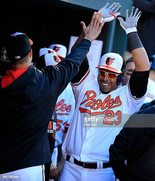 Nelson Cruz of the Baltimore Orioles celebrates in the dugout after hitting a solo home run during the seventh inning against the Boston Red Sox...