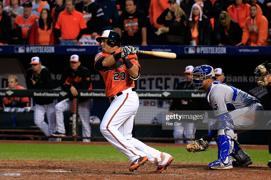 <a gi-track='captionPersonalityLinkClicked' href=/galleries/search?phrase=Nelson+Cruz&family=editorial&specificpeople=235459 ng-click='$event.stopPropagation()'>Nelson Cruz</a> #23 of the Baltimore Orioles grounds into fielder's choice to Alcides Escobar #2 of the Kansas City Royals scoring Alejandro De Aza #12 of the Baltimore Orioles to tie the game in the fifth inning during Game Two of the American League Championship Series at Oriole Park at Camden Yards on October 11, 2014 in Baltimore, Maryland.