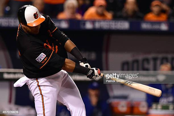 Nelson Cruz of the Baltimore Orioles hits a doubled to deep left field to score Alejandro De Aza in the fifth inning against James Shields of the...