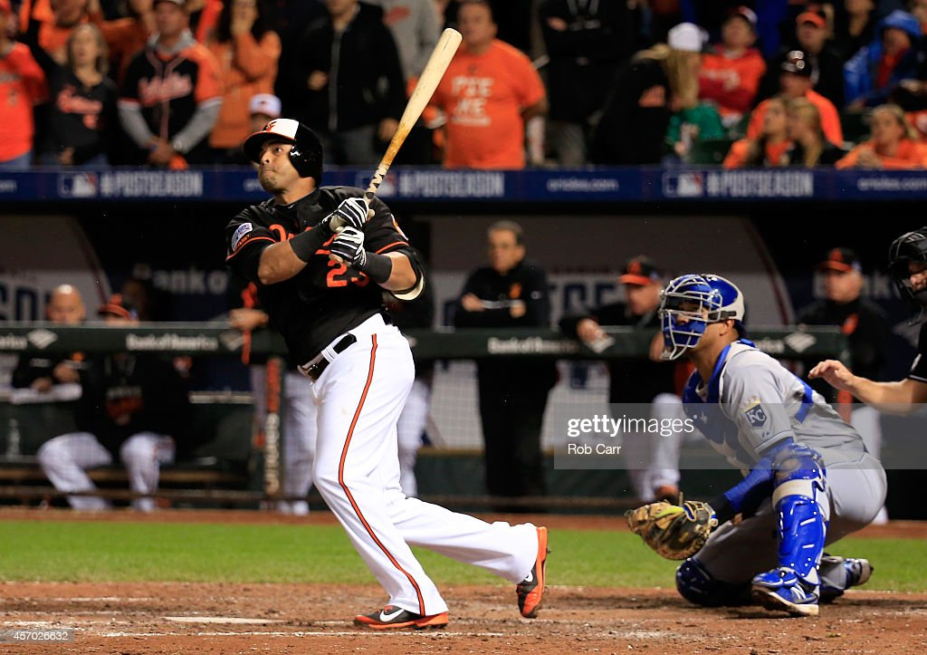 <a gi-track='captionPersonalityLinkClicked' href=/galleries/search?phrase=Nelson+Cruz&family=editorial&specificpeople=235459 ng-click='$event.stopPropagation()'>Nelson Cruz</a> #23 of the Baltimore Orioles hits a doubled to deep left field to score Alejandro De Aza #12 in the fifth inning against James Shields #33 of the Kansas City Royals during Game One of the American League Championship Series at Oriole Park at Camden Yards on October 10, 2014 in Baltimore, Maryland.