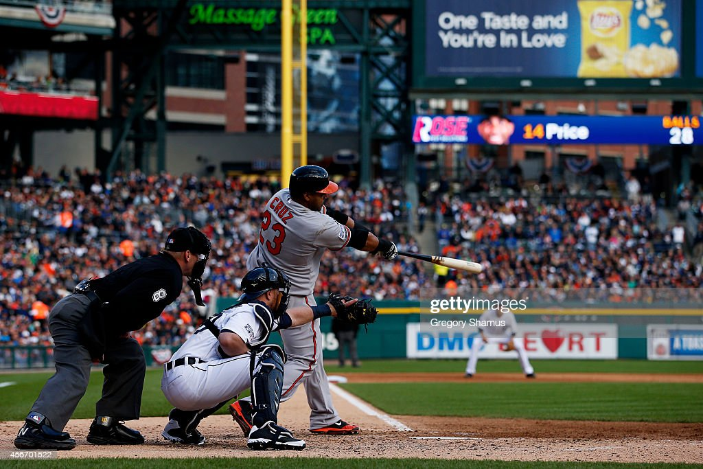 Nelson Cruz of the Baltimore Orioles hits a home run in the sixth inning against the Detroit Tigers during Game Three of the American League Division...