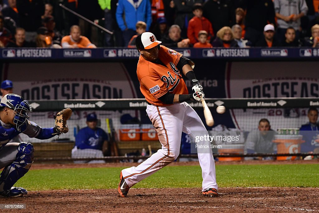 <a gi-track='captionPersonalityLinkClicked' href=/galleries/search?phrase=Nelson+Cruz&family=editorial&specificpeople=235459 ng-click='$event.stopPropagation()'>Nelson Cruz</a> #23 of the Baltimore Orioles hits a single to left field to load the bases in the seventh inning against Kelvin Herrera #40 of the Kansas City Royals during Game Two of the American League Championship Series at Oriole Park at Camden Yards on October 11, 2014 in Baltimore, Maryland.