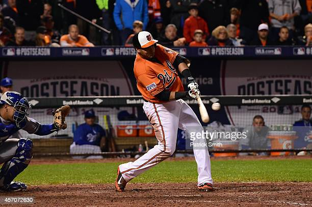Nelson Cruz of the Baltimore Orioles hits a single to left field to load the bases in the seventh inning against Kelvin Herrera of the Kansas City...