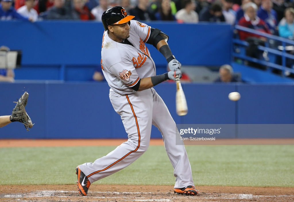 <a gi-track='captionPersonalityLinkClicked' href=/galleries/search?phrase=Nelson+Cruz&family=editorial&specificpeople=235459 ng-click='$event.stopPropagation()'>Nelson Cruz</a> #23 of the Baltimore Orioles hits a three-run home run in the sixth inning during MLB game action against the Toronto Blue Jays on April 22, 2014 at Rogers Centre in Toronto, Ontario, Canada.