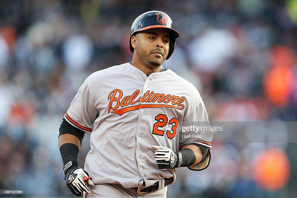 <a gi-track='captionPersonalityLinkClicked' href=/galleries/search?phrase=Nelson+Cruz&family=editorial&specificpeople=235459 ng-click='$event.stopPropagation()'>Nelson Cruz</a> #23 of the Baltimore Orioles rounds the bases after hitting a home run in the sixth inning against the Detroit Tigers during Game Three of the American League Division Series at Comerica Park on October 5, 2014 in Detroit, Michigan.