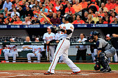 Nelson Cruz of the Baltimore Orioles watches as he hits a two run home run to right center field against Max Scherzer of the Detroit Tigers in the...