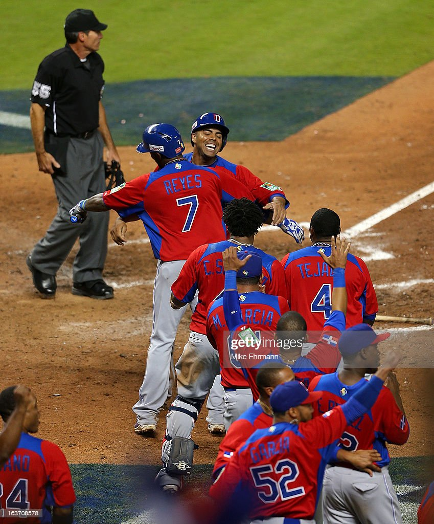 <a gi-track='captionPersonalityLinkClicked' href=/galleries/search?phrase=Nelson+Cruz&family=editorial&specificpeople=235459 ng-click='$event.stopPropagation()'>Nelson Cruz</a> #17 of the Dominican Republic celebrates after scoring a run during a World Baseball Classic second round game against the USA at Marlins Park at Marlins Park on March 14, 2013 in Miami, Florida.