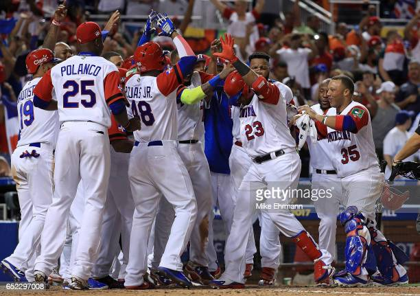 Nelson Cruz of the Dominican Republic is congratulated after hitting a three run home run during the eighth inning of a Pool C game of the 2017 World...