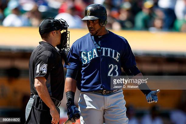 Nelson Cruz of the Seattle Mariners argues with umpire Mark Wegner after he was called out swinging during the seventh inning against the Oakland...