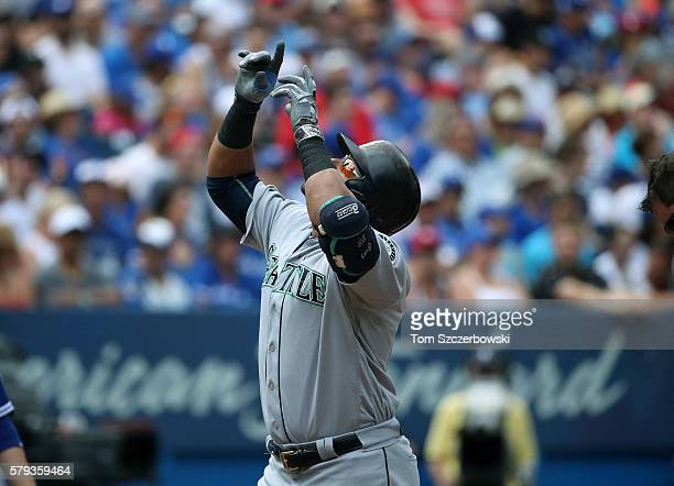 Nelson Cruz of the Seattle Mariners celebrates after hitting a grand slam home run in the third inning during MLB game action against the Toronto...