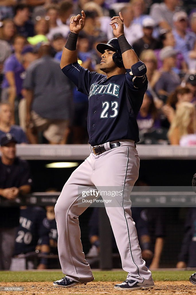 <a gi-track='captionPersonalityLinkClicked' href=/galleries/search?phrase=Nelson+Cruz&family=editorial&specificpeople=235459 ng-click='$event.stopPropagation()'>Nelson Cruz</a> #23 of the Seattle Mariners celebrates his solo home run off of Scott Oberg #45 of the Colorado Rockies to take a 6-4 lead in the seventh inning during interleague play at Coors Field on August 4, 2015 in Denver, Colorado.
