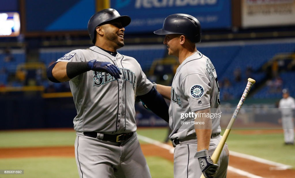 Nelson Cruz #23 of the Seattle Mariners celebrates with teammate Kyle Seager #15 after hitting a home run off of pitcher Brad Boxberger of the Tampa Bay Rays during the ninth inning of a game on August 18, 2017 at Tropicana Field in St. Petersburg, Florida.