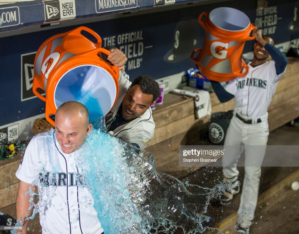 Nelson Cruz #23 of the Seattle Mariners dumps Gatorade on to Kyle Seager #15 of the Seattle Mariners as Jarrod Dyson #1 of the Seattle Mariners moves in with a second bucket after Kyle Seager #15 of the Seattle Mariners hits a walk off RBI-single during a game against the Detroit Tigers at Safeco Field on June 20, 2017 in Seattle, Washington. The Mariners won the game 5-4 in ten innings.