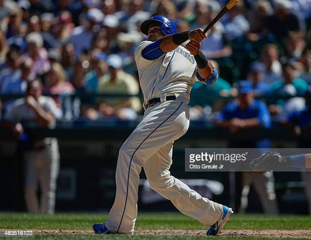 Nelson Cruz of the Seattle Mariners hits a solo home run in the sixth inning against the Texas Rangers at Safeco Field on August 9 2015 in Seattle...