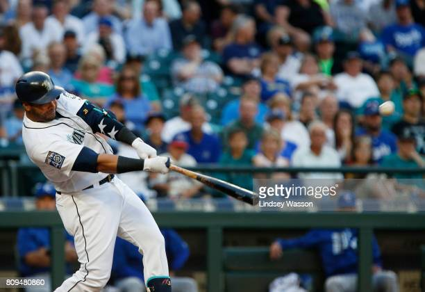 Nelson Cruz of the Seattle Mariners hits a solo home run off of starting pitcher Jason Vargas of the Kansas City Royals in the third inning at Safeco...