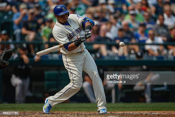 Nelson Cruz of the Seattle Mariners hits a tworun double against the Chicago White Sox in the third inning at Safeco Field on August 23 2015 in...
