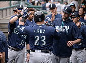 Nelson Cruz of the Seattle Mariners is congratulated in the dugout by teammates after hitting a home run during the game against the Detroit Tigers...