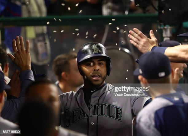 Nelson Cruz of the Seattle Mariners is showered with sunflower seeds as he celebrates with teammates after hitting a solo homerun during the fourth...