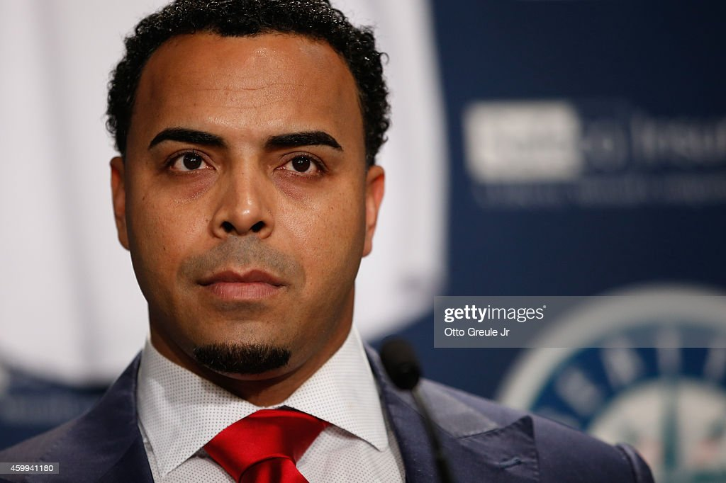 <a gi-track='captionPersonalityLinkClicked' href=/galleries/search?phrase=Nelson+Cruz&family=editorial&specificpeople=235459 ng-click='$event.stopPropagation()'>Nelson Cruz</a> of the Seattle Mariners looks on during his introductory press conference at Safeco Field on December 4, 2014 in Seattle, Washington.