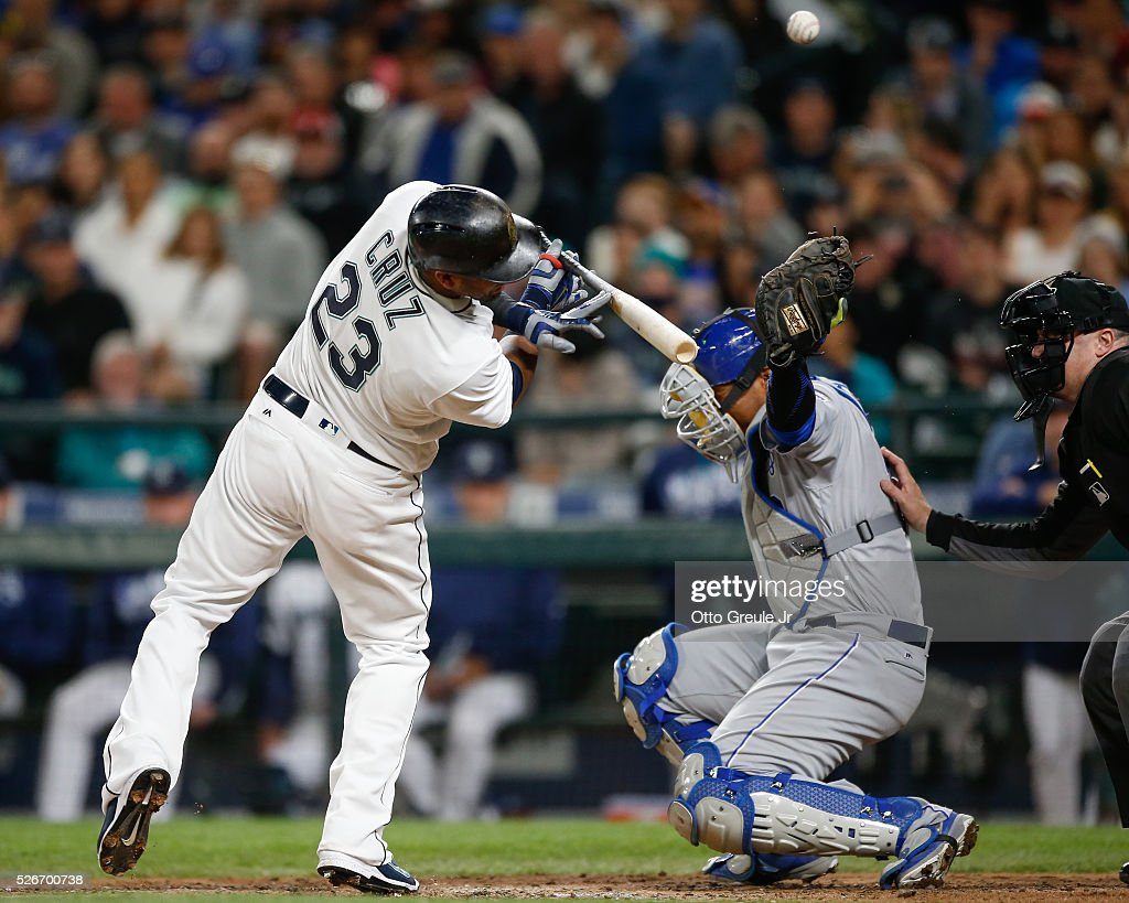 <a gi-track='captionPersonalityLinkClicked' href=/galleries/search?phrase=Nelson+Cruz&family=editorial&specificpeople=235459 ng-click='$event.stopPropagation()'>Nelson Cruz</a> #23 of the Seattle Mariners reacts after being hit with a pitch as catcher Salvador Perez #13 of the Kansas City Royals reaches for the ball in the sixth inning at Safeco Field on April 30, 2016 in Seattle, Washington.