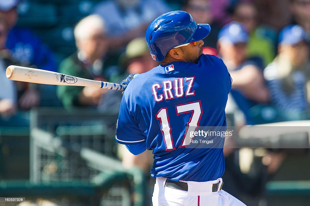 <a gi-track='captionPersonalityLinkClicked' href=/galleries/search?phrase=Nelson+Cruz&family=editorial&specificpeople=235459 ng-click='$event.stopPropagation()'>Nelson Cruz</a> #17 of the Texas Rangers bats during a spring training game against the Kansas City Royals t Surprise Stadium on February 24, 2013 in Surprise, Arizona.