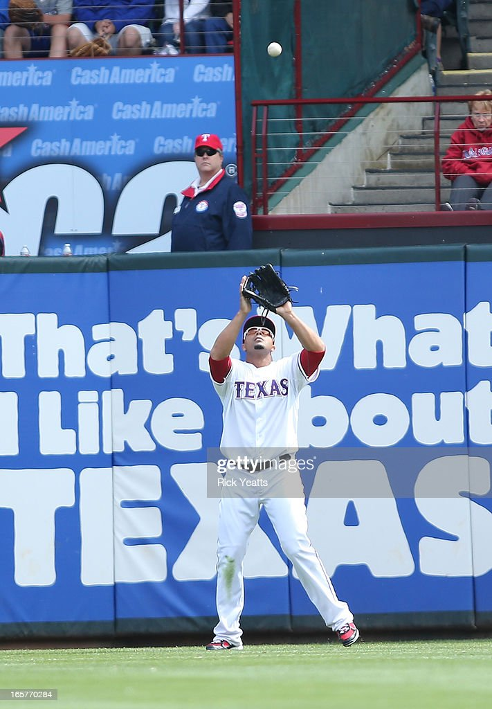 <a gi-track='captionPersonalityLinkClicked' href=/galleries/search?phrase=Nelson+Cruz&family=editorial&specificpeople=235459 ng-click='$event.stopPropagation()'>Nelson Cruz</a> #17 of the Texas Rangers catches a fly ball hit by Erick Aybar #2 of the Los Angeles Angels of Anaheim in the eighth inning at Rangers Ballpark in Arlington on April 5, 2013 in Arlington, Texas.