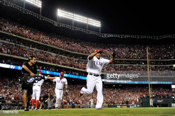 Nelson Cruz of the Texas Rangers celebrates after hitting a tworun home run in the seventh inning of Game Six of the American League Championship...