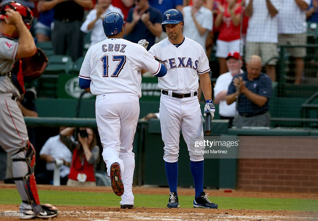 Nelson Cruz #17 of the Texas Rangers celebrates his homerun with David Murphy #7 against the Los Angeles Angels at Rangers Ballpark in Arlington on July 31, 2013 in Arlington, Texas.