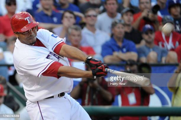 Nelson Cruz of the Texas Rangers celebrates hitting a home run in the seventh inning of Game Two of the American League Championship Series to tie...